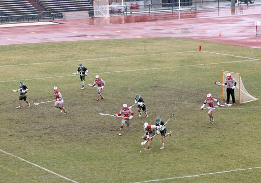 Members of the OSU lacrosse team rush to the ball during a game against Jacksonville March 29 at Jesse Owens Memorial Stadium. OSU won, 13-2. Credit: Dan Hope / Lantern photographer