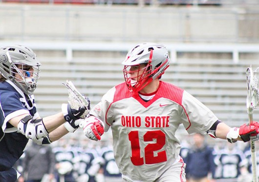 Junior midfielder David Planning (12) fights for position during a game against Penn State March 1 at Ohio Stadium. OSU lost, 11-8. Credit: Ryan Robey / For The Lantern