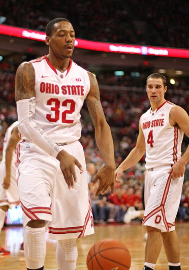 Senior guards Aaron Craft (4) and Lenzelle Smith Jr. (32) look on during a game against Iowa Jan. 12 at the Schottenstein Center. OSU lost, 84-74. Credit: Shelby Lum / Photo editor
