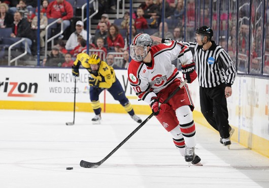 Junior forward Darik Angeli advances the puck during a game against Michigan March 2 at Nationwide Arena. OSU lost, 4-3. Credit: Ben Jackson / For The Lantern