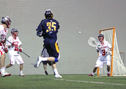 Senior goalkeeper Greg Dutton (3) attempts to save a shot during a game against Marquette Feb. 22 at the Woody Hayes Athletic Center. OSU won, 11-7. Credit: Brett Amadon / Lantern reporter