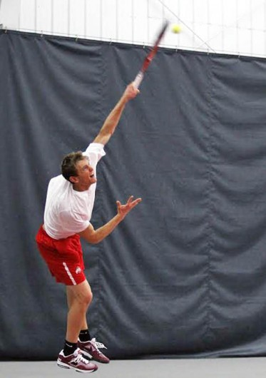 Redshirt-junior Kevin Metka hits the ball during a match against Michigan March 21 at the Varsity Tennis Center. OSU won, 6-1. Credit: Sam Harrington / Lantern photographer