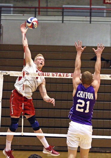Redshirt-junior opposite Andrew Lutz (11) strikes the ball during a match against Grand Canyon Feb. 21 at St. John Arena. OSU won, 3-0. Credit: Jonathan McAllister / Lantern photographer