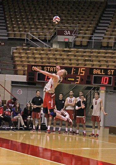 Redshirt-junior opposite Andrew Lutz attempts to serve the ball during a match against Ball State Feb. 26 at St. John Arena. OSU lost, 3-1.  Credit: Kathleen Martini / Oller reporter