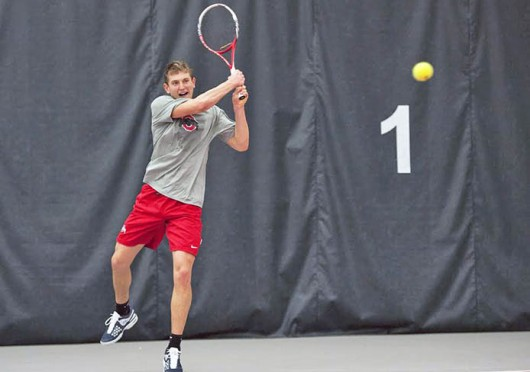 Junior Kevin Metka returns the ball during a match against North Carolina Feb. 28 at the Varsity Tennis Center. OSU won, 4-1. Credit: Ben Jackson / For The Lantern
