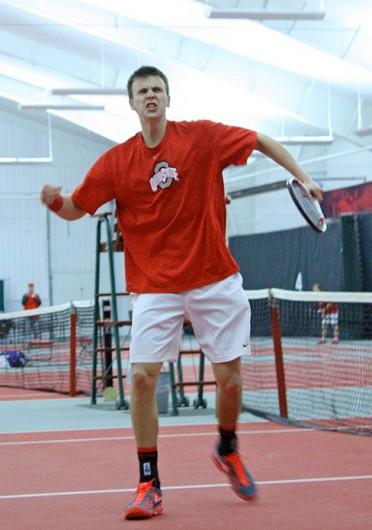 Senior Peter Kobelt celebrates during a match against Northwestern March 28 at the Varsity Tennis Center. OSU won, 4-3. Credit: Sam Harrington / Lantern photographer