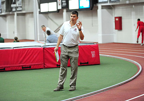 OSU men's track associate head coach Brice Allen signals the runners during a race at the Buckeye Classic Jan. 10 at French Field House. Courtesy of OSU athletics