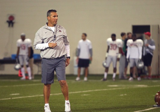 OSU coach Urban Meyer watches his team during spring practice March 20 at the Woody Hayes Athletic Center. Credit: Mark Batke / For The Lantern