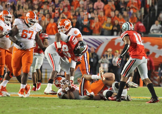 Then-sophomore defensive lineman Adolphus Washington (92) gets up after tackling an opposing player during the 2014 Discover Orange Bowl Jan. 3 at Sun Life Stadium. OSU lost, 40-35. Credit: Shelby Lum / Photo editor