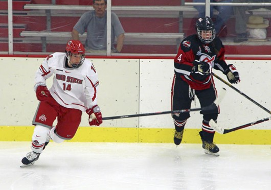 Senior defenseman Becky Allis attempts to chase down the puck during a game against the Toronto Aeros Sept. 28 at the OSU Ice Rink. OSU lost, 2-1. Credit: Chelsea Spears / Multimedia editor