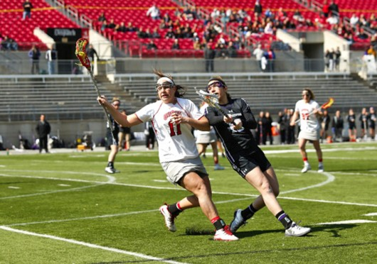 Senior attackman Katie Chase (11) handles the ball during a game against Northwestern March 9 at Ohio Stadium. OSU won, 11-10. Courtesy of OSU Athletics