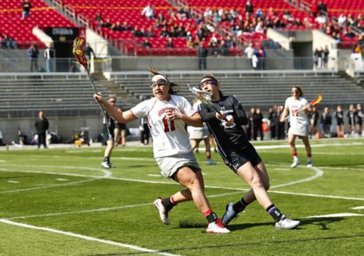Senior attackman Katie Chase (11) handles the ball during a game against Northwestern March 9 at Ohio Stadium. OSU won, 11-10. Courtesy of OSU Athletics