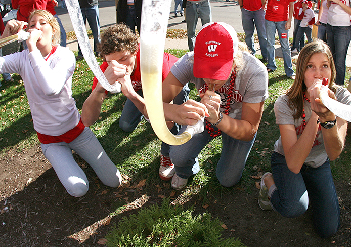 Wisconsin fans drink their beer bongs after a round of 'Drinko' before the Wisconsin football game on Oct.7, 2006. Credit: Courtesy of MCT