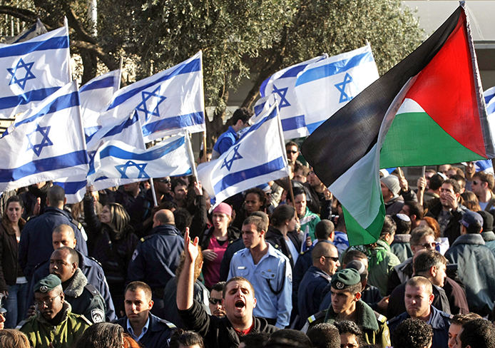 Almost 200 people took part in a demonstration held outside the Hebrew University in Jerusalem, Dec. 29, 2008, protesting the military operation in the Gaza Strip. The demonstrators held signs reading 'Free Gaza' and 'Free Palestine' and waved Palestinian flags.