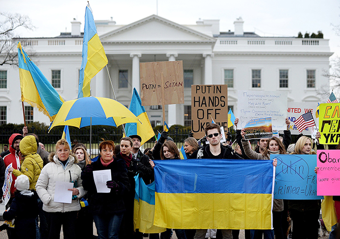 Protesters gather outside the White House to call on the US and European Union to do more to combat Russian aggression in Ukraine's Crimean Peninsula March 1 in Washington, D.C.