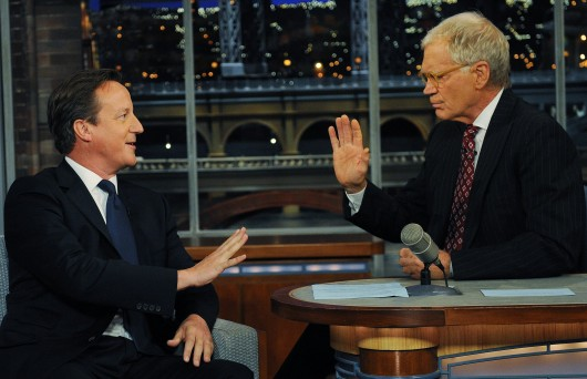 Prime Minister David Cameron (left) talks with talk show host David Letterman on 'Late Show with David Letterman' in New York City after he addressed the United Nations General Assembly Sept. 26, 2012.  Credit: Courtesy of MCT