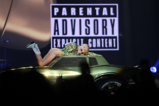 Pop singer Miley Cyrus performs on top of a car at the Schottenstein Center April 13 as a stop on her Bangerz tour.  Credit: Shelby Lum / Photo editor