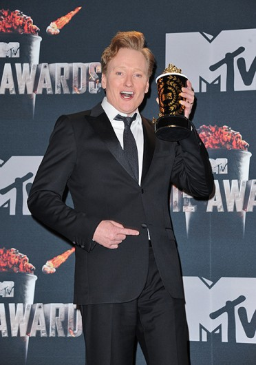 Host Conan O'Brien holds one of the awards as he poses in the press room during the 2014 MTV Movie Awards.Credit: Courtesy of MCT