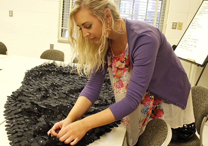 Christina Dawes, a fourth-year in fashion and retail studies, works on her garment for the 2014 FPA spring fashion show. The show, titled 'Incrementa: Seasons of the Self,' is set to be held in the Archie Griffin Ballroom April 12 at 8 p.m. Credit: Amanda Etchison / Lantern reporter