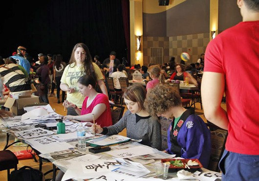 OSU students learn how to write Japanese characters at the 9th Annual Japanese Spring FEstival at the Ohio Union April 19.  Credit: Kaydee Laney / Lantern photographer