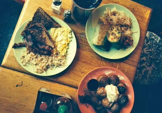 From left, clockwise: Katalina's classic breakfast, the Big 'Ol Breakfast Burrito and pancake balls. Credit: Leah Alexander / Lantern reporter