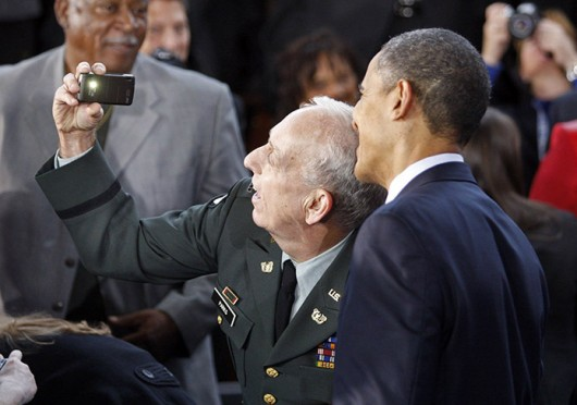 Perry Parks (left) takes a selfie with President Obama during the President's visit to Winston-Salem, N.C., on Dec. 6, 2010.  Credit: Courtesy of MCT