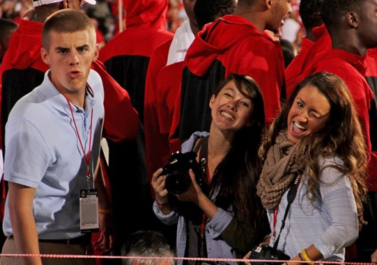 Shelby Lum (left) and Kaily Cunningham photograph OSU's football game against Wisconsin Sept. 28 at Ohio Stadium for The Lantern. Credit: Ritika Shah / Asst. photo editor