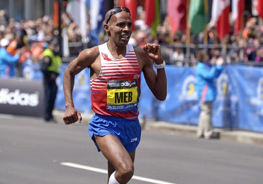 Meb Keflezighi wins the 118th Boston Marathon, a year after deadly bombings, near the Marathon finish line in Boston April 21. Keflezighi is the first American male to win since 1983. Credit: Courtesy of MCT