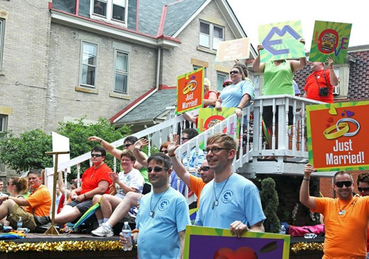 A float carries couples who were recently married June 22 on High Street as part of Pride Parade 2013. Credit: Shelby Lum / Photo editor