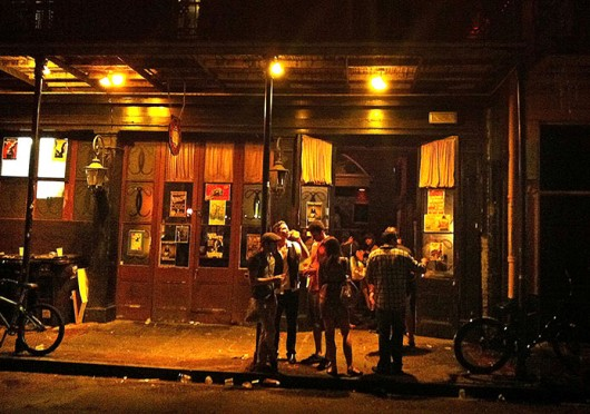 A crowd hangs out front of a bar in New Orleans. Bourbon Street in New Orleans is one of a few places in the U.S. where people are allowed to take certain open containers of alcoholic beverages to go. Credit: Courtesy of MCT