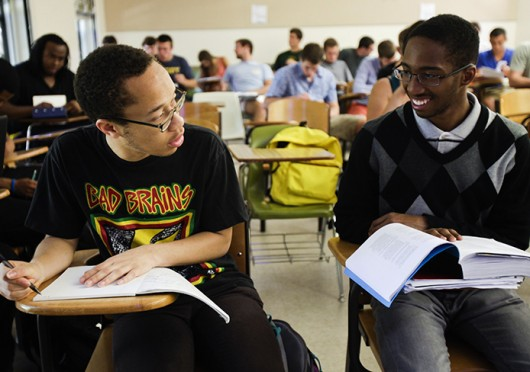 Spencer Simpson, left, and Kashawn Campbell chat before their African American studies class. Credit: Courtesy of MCT