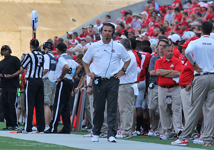 Coach Urban Meyer stands on the sidelines during a game against San Diego. OSU won, 42-7. Credit: Shelby Lum / Photo editor