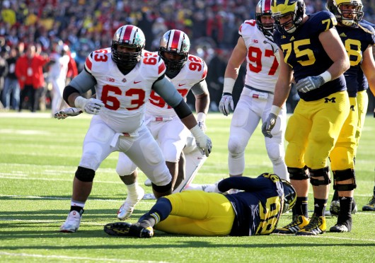 Then-junior defensive lineman Michael Bennett (63) celebrates a tackle during The Game Nov. 30 at Michigan Stadium. OSU won, 42-41. Credit: Shelby Lum / Photo editor