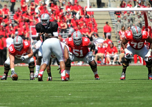 Junior center Jacoby Boren (50) and senior offensive lineman Joel Hale (51) prepare for a play during the 2014 Spring Game April 12 at Ohio Stadium. Gray beat Scarlet, 17-7. Credit: Mark Batke / For The Lantern