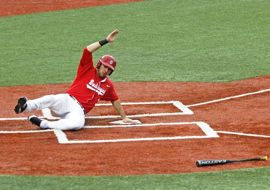 Junior outfielder Pat Porter (3) slides into home during a game against Toledo April 3 at Bill Davis Stadium. OSU won, 7-2. Credit: Elliot Schall / Lantern photographer