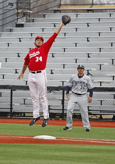 Sophomore first baseman Zach Ratcliff (34) jumps to catch the ball during a game against Xavier March 19 at Bill Davis Stadium. OSU won, 10-3. Credit: Sam Harrington / Lantern photographer