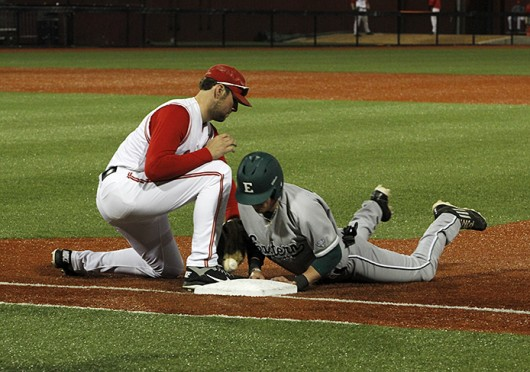 Redshirt-junior 1st baseman and pitcher Josh Dezse (left) tags the runner during a game against Eastern Michigan April 8 at Bill Davis Stadium. OSU won, 8-1. Credit: James Grega Jr. / Lantern reporter