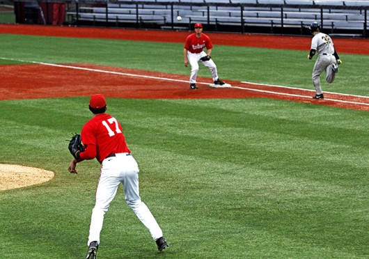 Sophomore infielder Jacob Bosiokovic (17) throws to 1st base during a game against Toledo April 2 at Bill Davis Stadium. OSU won, 7-2. Credit: Elliot Schall / Lantern photographer