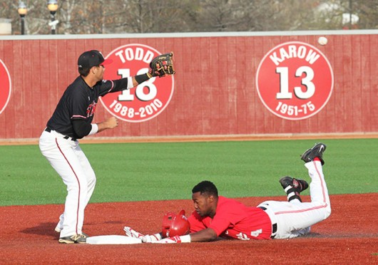 Freshman left-fielder Ronnie Dawson (right) slides into 2nd base during a game against Ball State April 16 at Bill Davis Stadium. OSU lost, 8-6. Credit: Brian Bassett / Lantern photographer