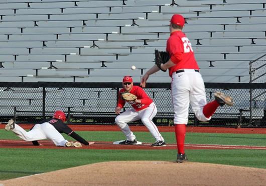 Freshman pitcher Curtiss Irving (26) throws the ball to redshirt-junior Josh Dezse (33) during a game against Ball State April 17 at Bill Davis Stadium. OSU lost, 8-6. Credit: Brian Bassett / Lantern photographer