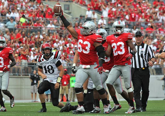 Then-junior defensive lineman Michael Bennett (63) celebrates recovering a fumble during a game against San Diego State Sept. 7 at Ohio Stadium. OSU won, 42-7. Credit: Shelby Lum / Photo editor