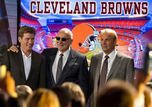 Denis Leary (left), Frank Langella (center) and Kevin Costner (right) pose in front of the Cleveland Browns logo. The three actors star in 'Draft Day,' released April 11. Courtesy of MCT