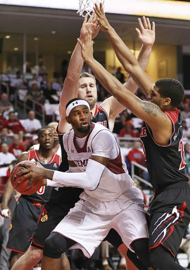 Then-Temple senior forward Anthony Lee (center) looks for an open teammate during a game against Louisville Feb. 14 at the Liacouras Center. Temple lost, 82-58. Courtesy of MCT