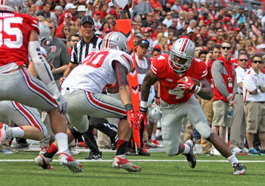 Freshman H-back Curtis Samuel (4) attempts to avoid a defender during the 2014 Spring Game April 12 at Ohio Stadium. Gray beat Scarlet, 17-7. Credit: Shelby Lum / Photo editor
