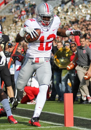 Then-junior cornerback Doran Grant (12) scores a touchdown during a game against Purdue Nov. 2 at Ross-Ade Stadium. OSU won, 56-0. Lantern file photo