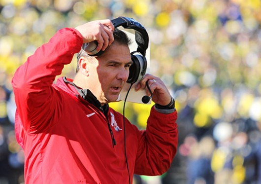 OSU coach Urban Meyer removes his headset on the sideline during a game on Nov. 30, 2014 at Michigan Stadium. OSU won, 42-41. Credit: Ritika Shah / Asst. photo editor