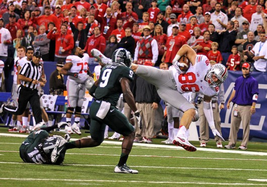 Then-junior tight end Jeff Heuerman (86) is brought down during the Big Ten Championship Game against Michigan State Dec. 7 at Lucas Oil Stadium. OSU lost, 34-24. Credit: Shelby Lum / Photo editor
