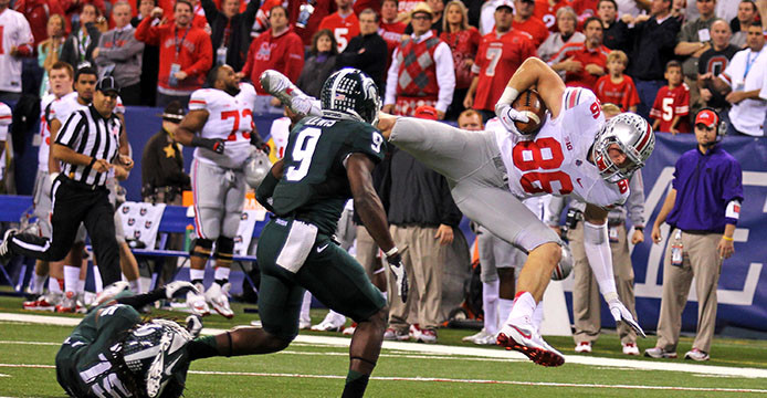 Then-junior tight end Jeff Heuerman (86) is brought down during the Big Ten Championship Game against Michigan State Dec. 7, 2013 at Lucas Oil Stadium. OSU lost, 34-24. Credit: Lantern file photo