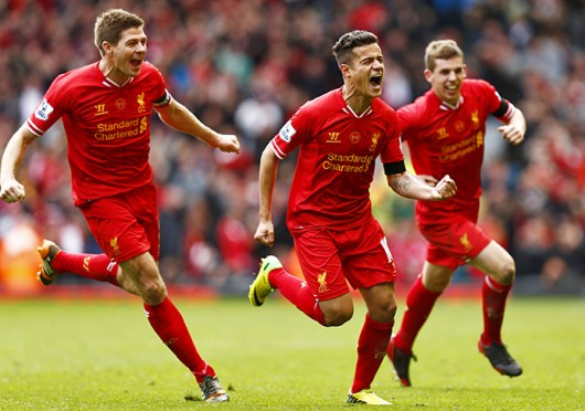 Liverpool midfielders Philippe Coutinho (center) and Steven Gerrard (left) and defender John Flanagan (right) celebrate scoring a goal during a match against Manchester City April 13 at Anfield. Liverpool won, 3-2. Courtesy of MCT