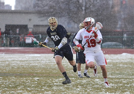 Junior midfielder Jesse King (19) looks for an open teammate during a game against Notre Dame March 25 at Jesse Owens Memorial Stadium. OSU won, 13-7. Credit: Shelby Lum / Photo editor